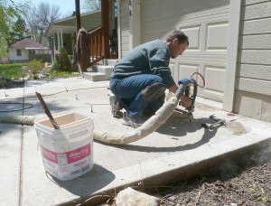 Jason Roland fixing a driveway for Concrete Raising Systems 7318 N Donnelly Ave. Kansas City,MO 64158
