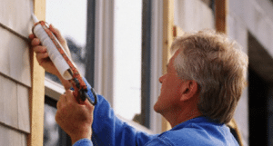 Man caulking windows, Concrete Raising Systems 7318 N Donnelly Ave. Kansas City,MO 64158