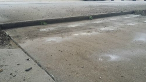 Driveway-at-street-Before-Foam-Lifting-Concrete-Raising-Systems-7318-N-Donnelly-Ave-Kansas-City-MO-64158500