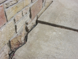Sidewalk repair before
