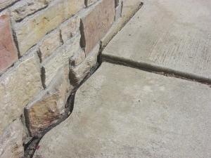 Sidewalk repair before